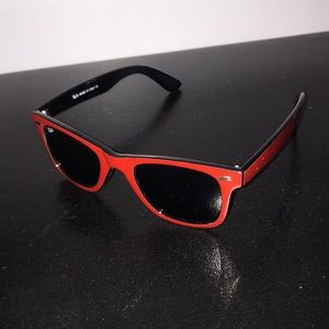 Women's red and black Ray-Ban sunglasses.